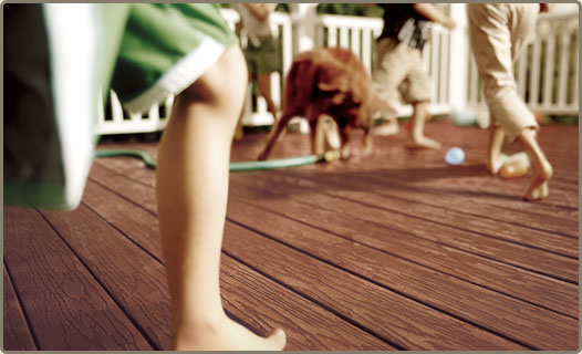 close-up of decking with legs and feet running across